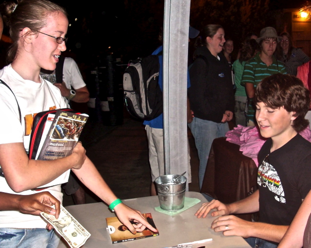 Zach is busy signing copies of Be the Change to encourage students like our Emmah.  July - '07